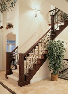Impressive staircase in this grand two story entrance. Traditional House Plan # 121130.