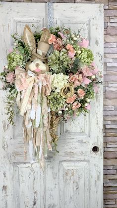 A lovely wreath filled with a garden of flowers and soft colors. A sweet sissl bunny is all dressed up in his top hat and rag bow and he's off to enjoy a leisure stroll through his garden, might even stop for a bit of tea. This wreath is made on a soft mesh base and is accented with flowers, greenery, berries, ribbons. Wreath Crafts, Diy Wreath, Door Wreaths, Corona Floral, Easter Wreaths, Spring Crafts, Easter Crafts, Floral Wreath, Soft Colors