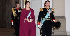 Crown Prince Frederik Crown Princess Mary wore red cape, Gianvito Rossi suede pumps, Diamond Tiara, Hugo Boss clutch, diamond earrings, Prada handbags