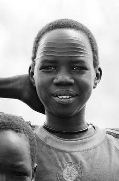 Africa | Nuer boy.  Ayod, Jonglei, South Sudan | ©Ngari