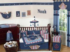 Nautical baby room with soft and bold blue color schemes also dark brown furniture sets