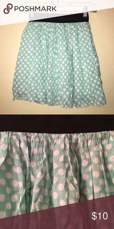 Polka Dot Flowy Skirt Light green floral mini skirt with white polka dot. Black elastic band. Soft material. Size XS. Skirts Mini