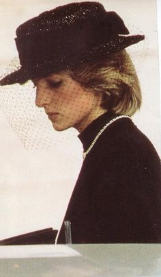 Princess Diana attending the Funeral of Princess Grace of Monaco September 18, 1982. Diana is wearing a simple black dress by Jasper Conran.