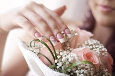 French manicure with a simple design on the ring finger... great wedding nail art