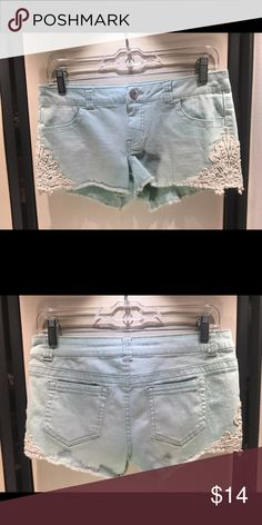 Mossimo Mint Colored Jean Shorts with Lace Accents These shorts are comfortable and chic. They have cream lace detailing on the sides and we're only worn twice. Measurements available upon request. No damage unless explicitly stated!  Mossimo Supply Co. Shorts Jean Shorts
