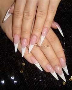 Stiletto nails - long nails.  Seriously uGly!  Seriously some dangerous weapons - like in the bathroom...DuH!!
