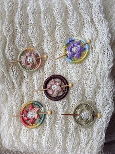 These look like Dorset Buttons although they are sold as Ring Work Shawl Pins. Crochet Buttons, Crochet Motif, Crochet Shawl, Crochet Patterns, Button Art, Button Crafts, Textiles, Dorset Buttons, Passementerie