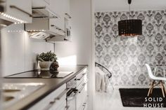 Beautiful wallpaper in this kitchen! Solid House