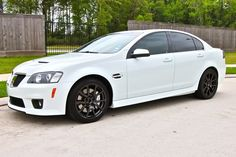 Pontiac G8 Gxp with ctsv wheels. Too bad they quit making this car, I want one.