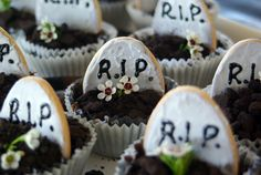 """Halloween RIP cupcakes: looks like iced arrowroot biscuits cut in 1/2 with """"oreo dirt"""" & could do green icing grass instead of flower?? not sure of original link :("""