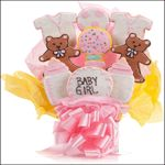 It's a Girl Bouquet - This delicious arrangement of Cookie Blooms is a gift that is always in good taste and is sure to delight cookie lovers of all ages! Our Cookies are handmade Vanilla Sugar Cookies, freshly baked and iced. This popular assortment is a great gift for a New Baby Girl and features brilliantly hand decorated Teddy Bears, Rattles, Bottles, Onesies and a Cookie Plaque that conveys your message! Choose our 5, 7, 9 or 12 pc arrangement of Cookie Blooms.