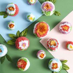 Create an adorable arrangement of pretty pom-pom flowers no matter the season. Craft Stick Crafts, Diy And Crafts, Arts And Crafts, Preschool Crafts, Craft Ideas, Pom Pom Crafts, Yarn Crafts, Pom Pom Flowers, Pom Pom Maker