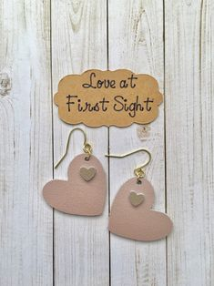 Genuine leather earrings, rose gold heart shape, gold heart overlay, Love at First Sight by ShorelineGraphixInc on Etsy https://www.etsy.com/listing/589816084/genuine-leather-earrings-rose-gold-heart