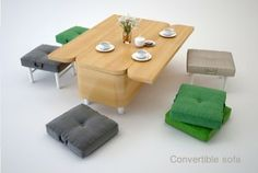 Convertible coffee-table/sofa/dining room table +stools