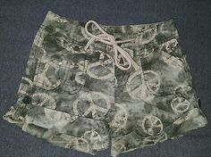 Girls Justice cotton shorts size 7 slim peace sign green tan
