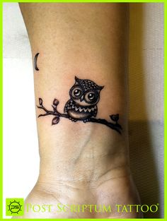 Back tattoo on the right side. Owl tattoo with raylees name by the moon. Below it do the same except Bailee's name by the moon