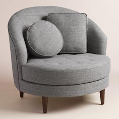 In a round, on-trend shape, our chair-and-a-half makes a mid-century style statement as big as its oversized seat. Woven two-tone upholstery covers this ultra-comfortable chair with tufting detail - it's a perfect match with our coordinating half-moon ottoman.