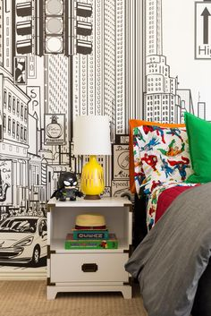 Move over, Captain America and Hulk, because this superhero-themed boy's room is packing its own punch. Designers Jen and Jo drew on graphic wallpaper, pillows and art to bring color and character to this contemporary kids' space.