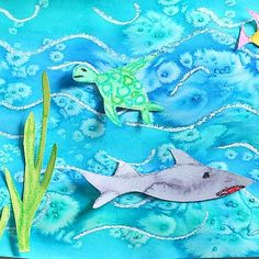 We used a super fun watercolor paint technique to make ocean scenes! Directions are up #ontheblog ! #momsoninstagram #rockinartmoms #summer #sharkweek
