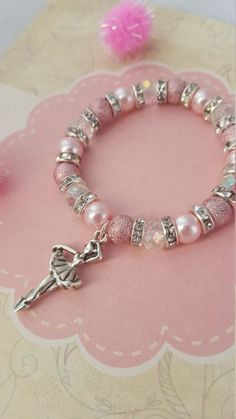 A sparkly ballerina bracelet with crystals and glitter beads! This gorgeous bracelet is also available in bigger sizes! Kids Charm Bracelet, Kids Bracelets, Handmade Bracelets, Jewelry Bracelets, Pandora Bracelets, Ankle Bracelets, Kids Jewelry, Jewelry Crafts, Jewelry Making