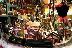 Train in action in miniature Christmas village
