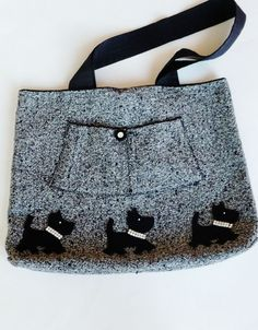 handmade original OOAK paroliro design: recycled vintage black and white tweed wool fabric lined in black cashmere created into a tote bag, purse or computer carry bag.  Three black Scottie siblings strut across the bottom with their faux diamond collars.  [*Click on image to see full details, measurements and 4 more photo views.]  For sale at paroliro on Etsy.  $48.00