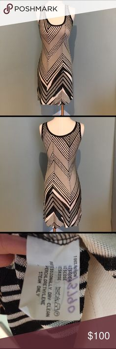 Missoni black and white patterned dress. Size 40. Elegant black and cream/white patterned knit dress with no slip. This dress is a size 40 and is thin knit, might need a slip. Very comfortable. Missoni Dresses