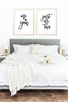 I like the grey bed and the two golden frames, but not those specific quotes