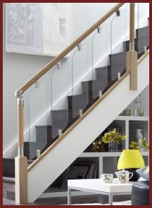 Modern Staircase Of Wood And Glass Railings