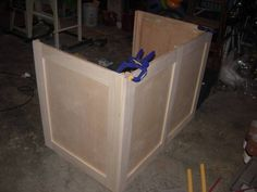 The outer panels are made for the freezer base. Use this idea for a way to have a chest freezer. Hide it in plain sight.