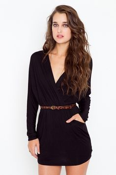 Ultra-drapey black dress featuring a plunging wrap top and cutout detail at back.