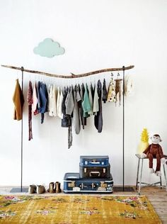 The ABSOLUTE cutest exposed closet. Stacked suitcases for storage. Line up shoes. Hang necklaces/jewellery on the wall.: