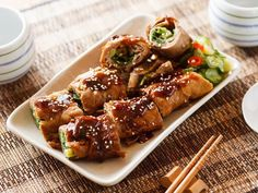 Pork rolled scallion with oyster sauce Ingredients 1.Pork blade shoulder 150g 2.Scallion 30g 3.Soy sauce 5ml 4.Rice wine 5ml 5.Sugar 5g 6.Water 5ml 7.Potato starch g 8.Oyster sauce 20ml 9.Sesame 1g Method 1.Pork blade shoulder cut into thin piece    2.Pork season with (soy sauce, rice wine, sugar, water, potato starch)  3.Roll with scallion    4.Outside bush oyster sauce to barbecue and present with sesame