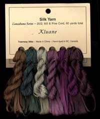 """kluane"" hand dyed silk ""yarn"" ( which are embroidery threads, really) & silk ribbon underneath  *treenway silks website"