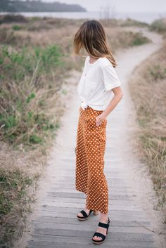 Jess Ann Kirby styles a spring look with statement wide leg pants and a simple tee from Anthropologie Wide Leg Cropped Pants, Wide Pants, Dots Fashion, Colorful Fashion, Fashion Outfits, Polka Dot Pants, Polka Dots, Fall Capsule Wardrobe, Affordable Clothes
