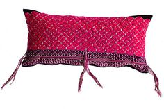 Reinterpreting ethnic textiles is a passion of mine. This Gorgeous Pwo Karen pillow is made from traditional an ethnic Hmongblouse that was hand-woven on traditional back-strap loom. These blouses are only worn by married women and are as unique as they are colorful. Each woman has her own style of embroidery and preference for decorating with Job's tears seed appliqué and other embellishments.Thispillow features bright pink floral embroidery with tassels and is backed in black. #pillows ...