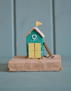 A personal favourite from my Etsy shop https://www.etsy.com/uk/listing/246393214/miniature-driftwood-green-beach-hut