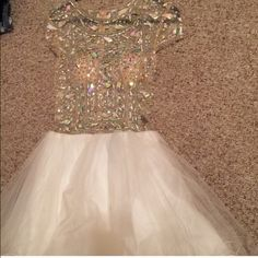 Prom dress Beautiful gold sheer with embellishments and a white bottom to this size 2 zip up dress. Worn once and is still in great condition! This dress NEEDS to go!  Terani Couture Dresses Prom