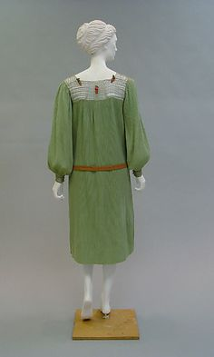 Ensemble Paul Poiret  (French, Paris 1879–1944 Paris)  Date: 1925–26 Culture: French Medium: wool, metal, leather. Back