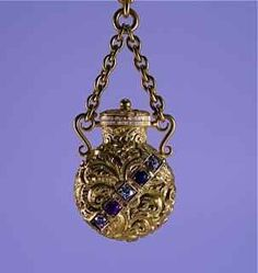 1890s   Chatelaine perfume bottle in 14K gold repousse, with hinged cover, set with ruby, sapphire and diamonds, on original chain.