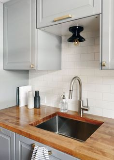 How to design and build an IKEA kitchen from start to finish! via Yellow Brick Home | IKEA kitchen, small kitchen, kitchen ideas, gray cabinets, butcher block kitchen, low ceiling kitchen, easy kitchen design #ikeakitchen