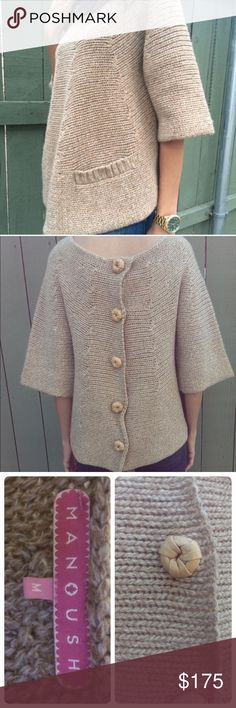 Manoush Chunky knit Sweater w/ buttons down back Beautiful. Camel colored sweater. Chunky knit. Three-quarter sleeves with front pockets with snap closure. Leather wrapped buttons down the back. Functional snap closure behind each button. Size medium. Could fit a small or medium. Worn once. Perfect condition. Manoush Sweaters
