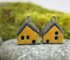 Hand formed micro houses - made with white raku clay. Low fire glaze on the walls, unglazed roof. Inserted (fired) nichrome wire loop for hanging.  ELUKKA  shop on Etsy