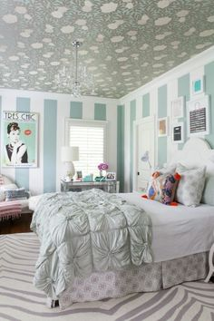 Lots of soft colored pattern in this aqua tween girl's room