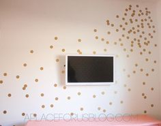 Above the changing table I'm thinking with gray wall and white dots