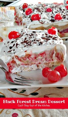 Black Forest Dream Dessert -this spectacular dessert has a coconut walnut crust, a cheesecake layer, a cherry pie filling layer, a chocolate pudding layer and it's topped with whipped topping, chocolate shavings and maraschino cherries