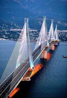 """The – Bridge is the world's longest multi-span cable-stayed bridge. It crosses the Gulf of Corinth near Patras, linking the town of Rio on the Peloponnese to Antirrio on mainland Greece. This is the landmark of Greece's Century. Patras, Mykonos, Santorini, Places To Travel, Places To See, Famous Bridges, Beau Site, Bridge Design, Covered Bridges"