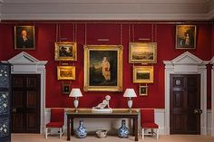 red dining room wall at Dumfries House, Scotland