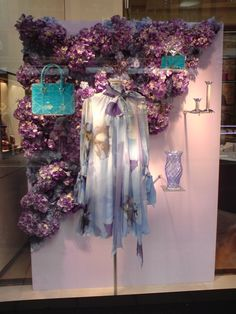 This is a close window display because customers cannot see into the store through the window. The decor is spring because of the flowers and the colors.