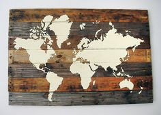 Ignite your wanderlust by stenciling a world map onto a base of deconstructed wood pallet planks. Get the tutorial at The Merrythought.   - CountryLiving.com